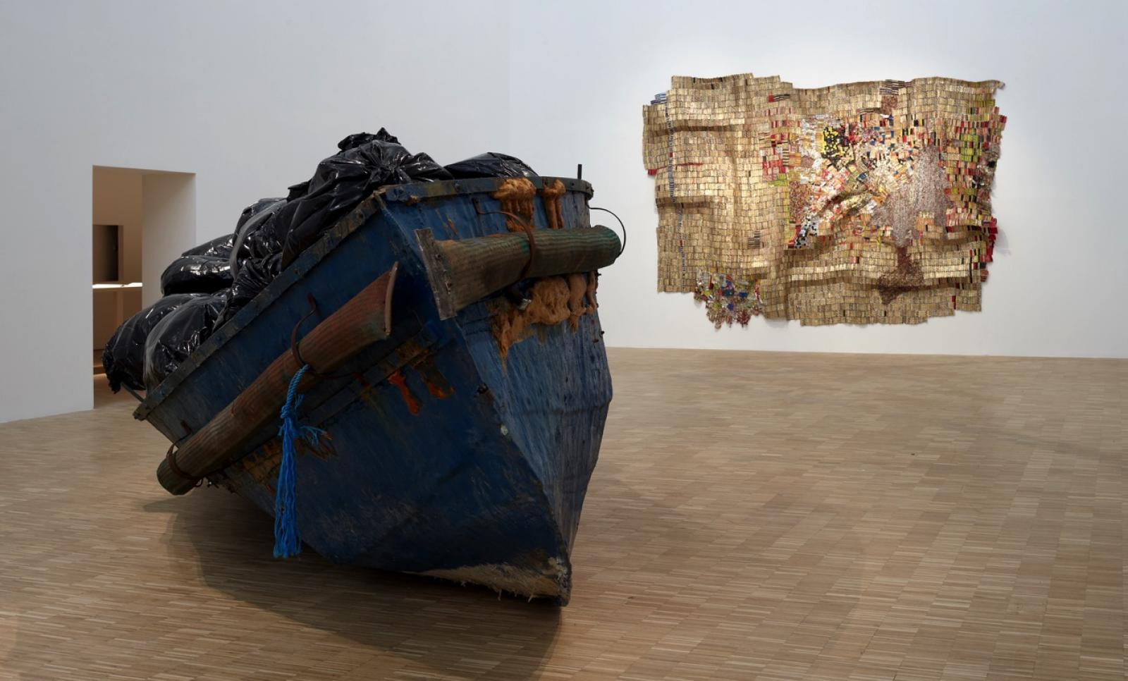 Adel Abdessemed /Hope /(2011-15) Courtesy Adel Abdessemed  El Anatsui /New World /(2009) Courtesy El Anatsui and Jack Shainman