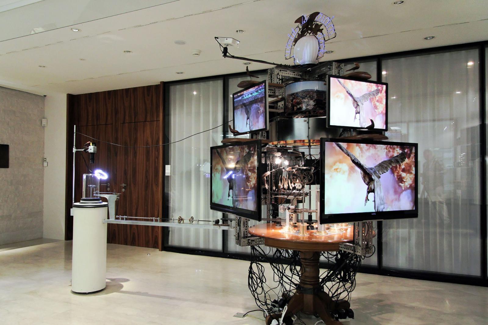 Jon Kessler Installation view /The World Is Cuckoo /atLes Ambassadeurs watch shop Photo: Manifesta 11 / Wolfgang Träger