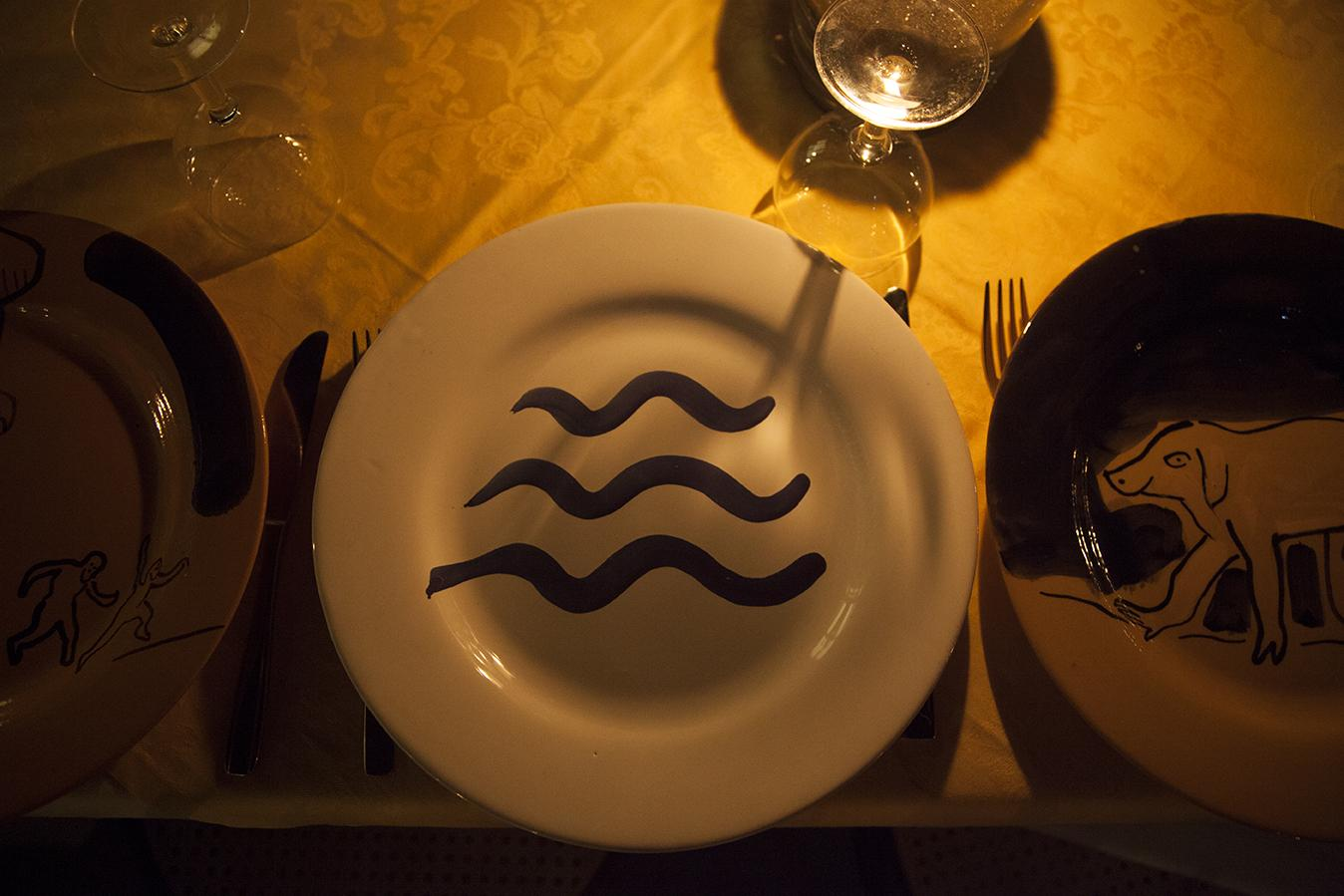 Ceramic plate by Camille Henrot depicting scenes from the Odyssey for the  dinner at Zurro on the opening night Photo: Giovanna Silva Courtesy Fiorucci Art Trust, London