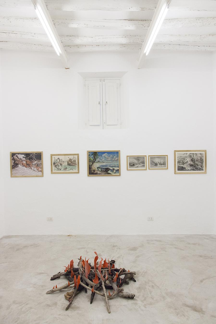 "Installation view ""I Will Go Where I Don't Belong"" On the back: Works from the Henrot Family Collection In the front: Mike Nelson, /Diyagram (Amnesiac beach fire)/, 2015 Wood and plastic © Mike Nelson, courtesy 303 Gallery, New York  Photo: Giovanna Silva. Courtesy Fiorucci Art Trust, London"