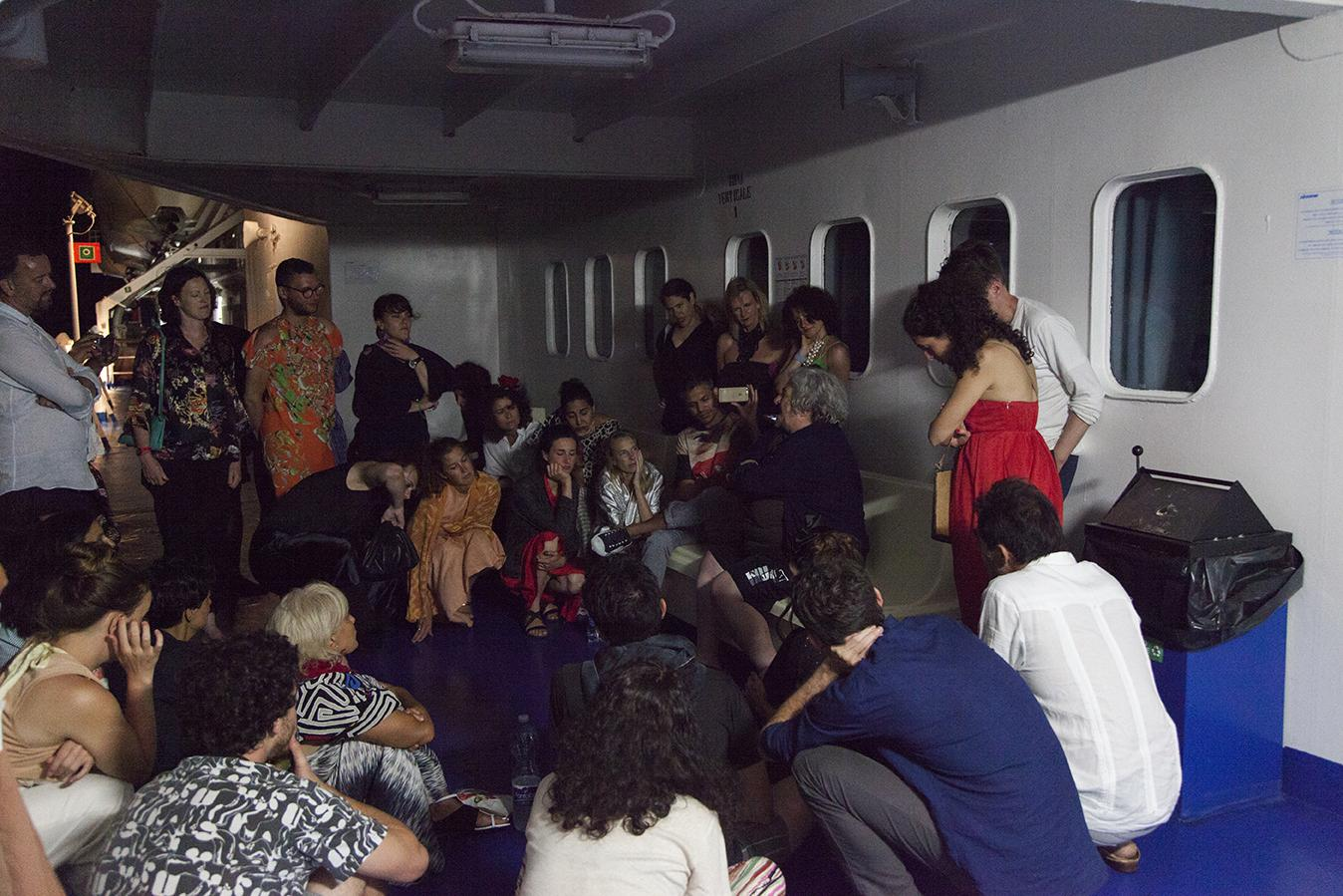 Artist Anna Boghiguian talking on the Siremar night ferry on Day 7: /Exile/ Photo: Giovanna Silva Courtesy Fiorucci Art Trust, London