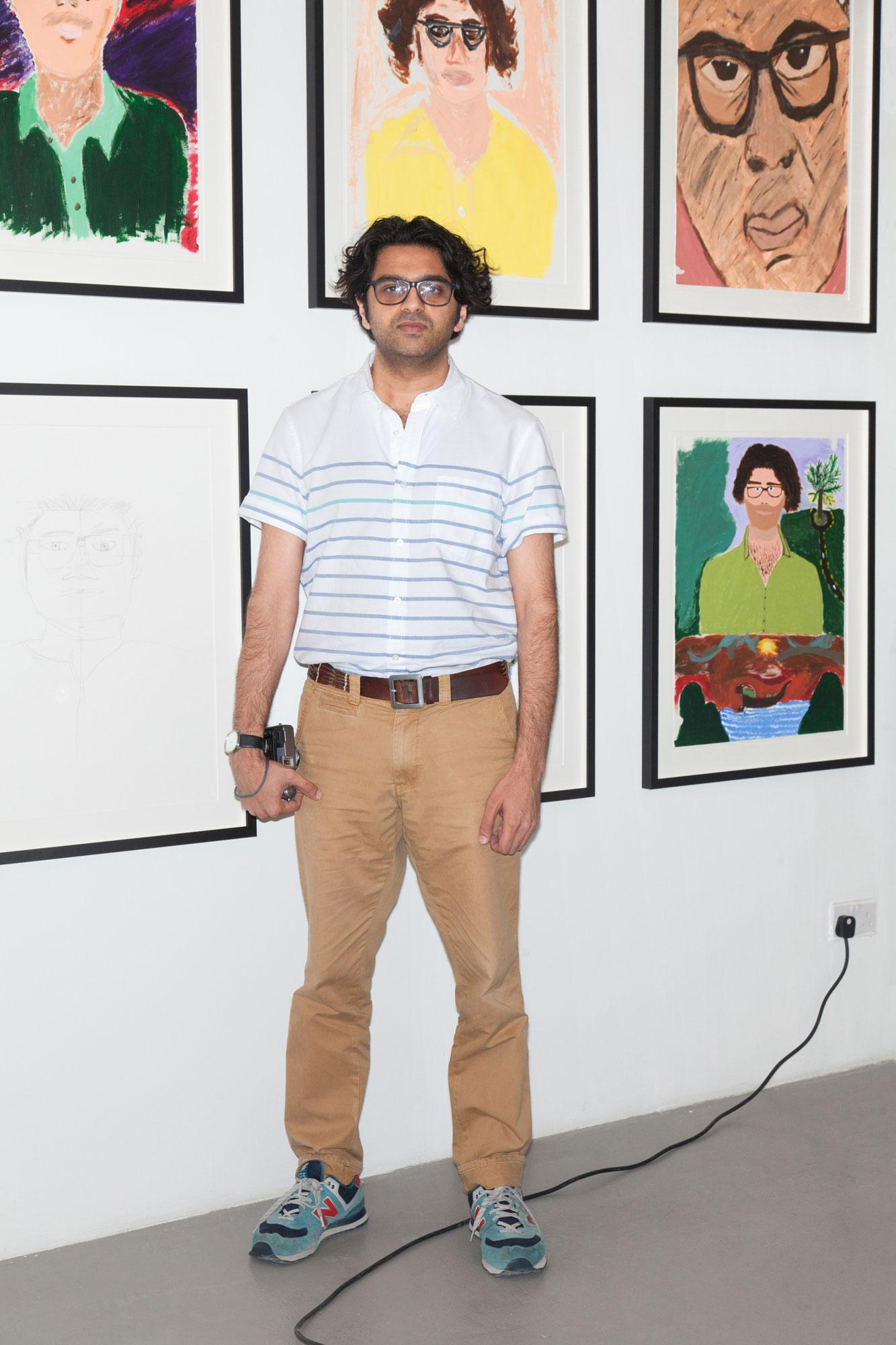 "Artist Vikram Divecha in his show ""Portrait Sessions"" at Al Tashkeel"