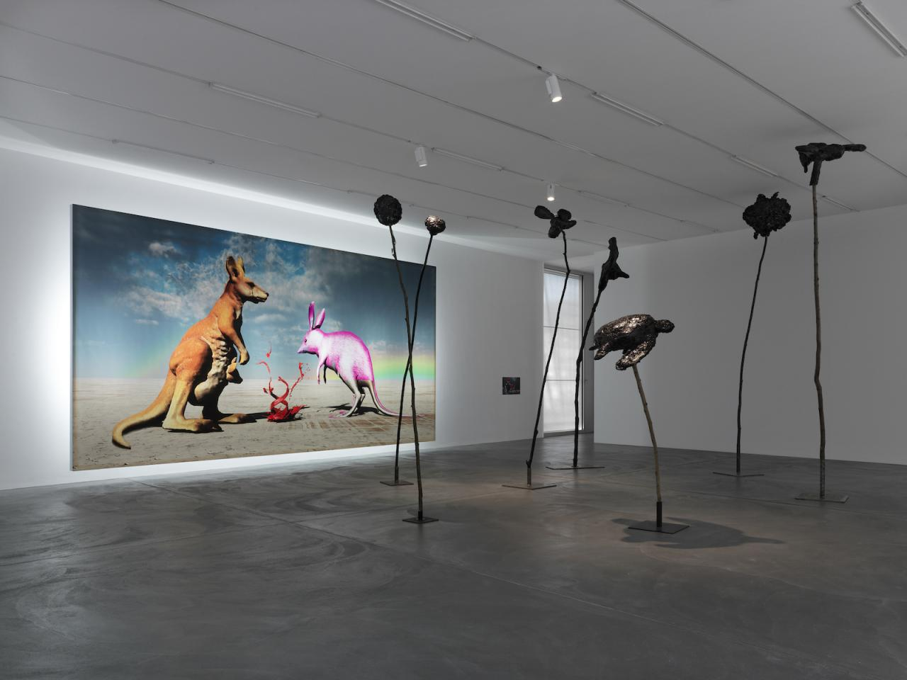 "View of ""DOGGO"" Background: Judgement. The kangaroo is not happy. it's not clear who or what it represents but it's not in a good place  (2014) Backlit digital print on vinyl, 400 x 786 cm Photo: Annik Wetter"