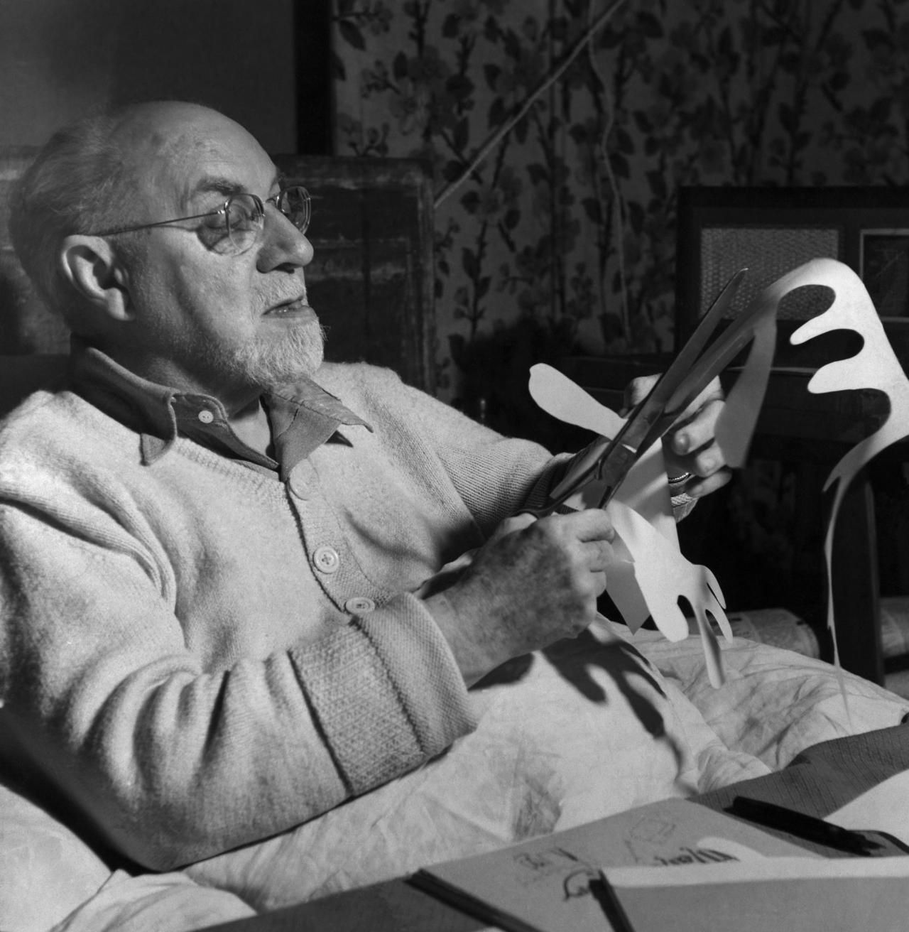 Henri Matisse working on paper cut out, n.d.