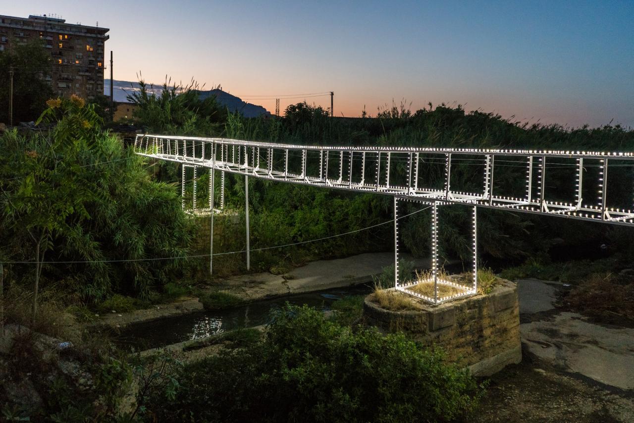 Roberto Collovà, Ponte Luminaria. Giardino di giardini. Azioni sulla Costa Sud, 2018, mixed media, installation view, Oreto River, Palermo