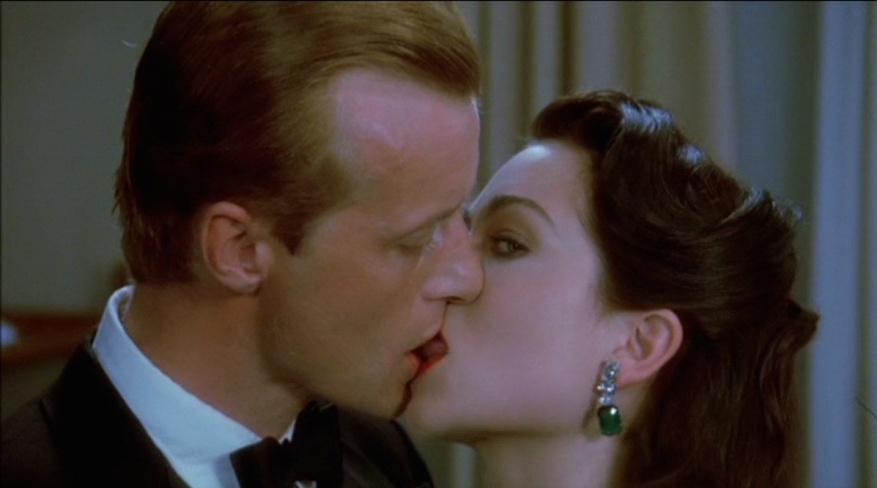 Rutger Hauer and Theresa Russell share a kiss in Eureka (1983)