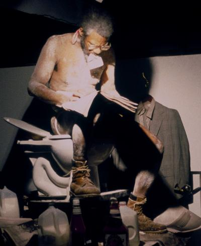 Eating the Wall Street Journal (3rd version) , 2000, Mixed media installation with performance, SculptureCenter New York