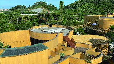 Rooftop view of the main architectural complex. The Museum of the Wind can be seen in the distance.
